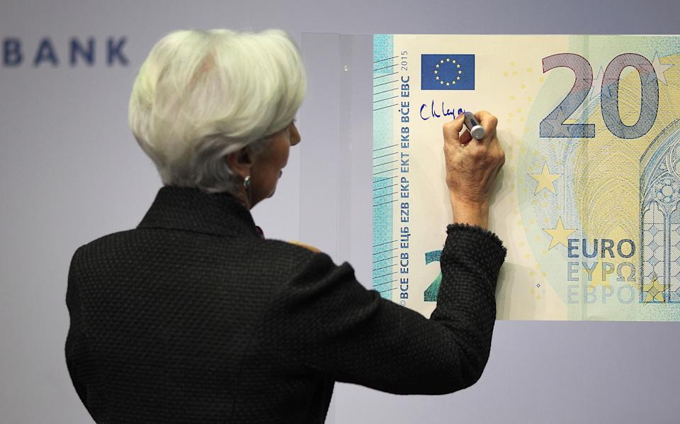 Christine Lagarde, President of the European Central Bank (ECB), gives her signature to be printed on Euro banknotes in Frankfurt am Main, western Germany, on November 27, 2019. (Photo by Daniel ROLAND / AFP) (Photo by DANIEL ROLAND/AFP via Getty Images)