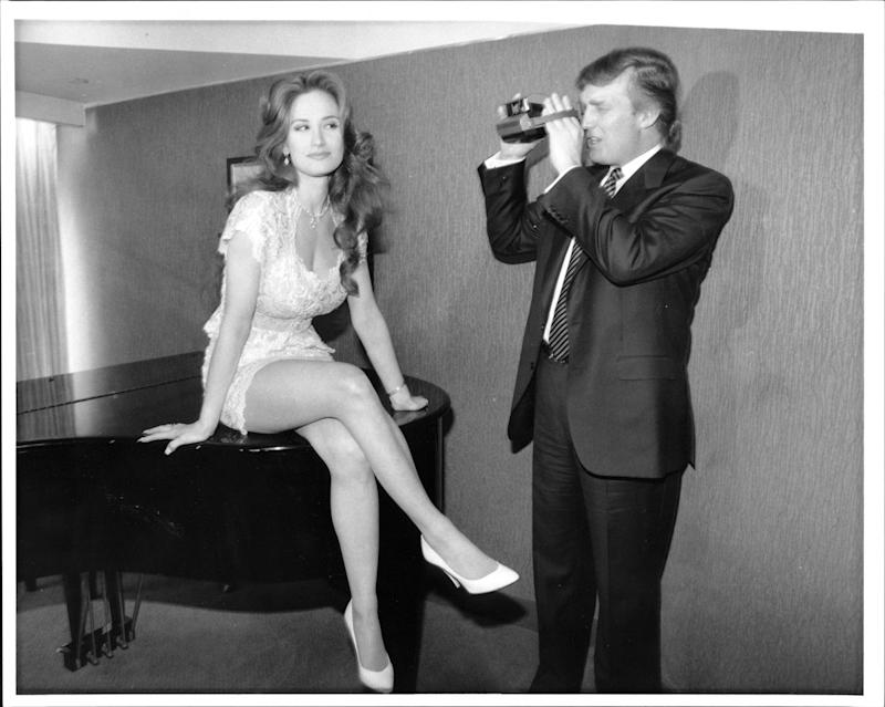 Donald Trump photographs and interviews Playboy centerfold hopefuls at the U.N. Plaza hotel for the magazine's 40th anniversary issue in June 1993.