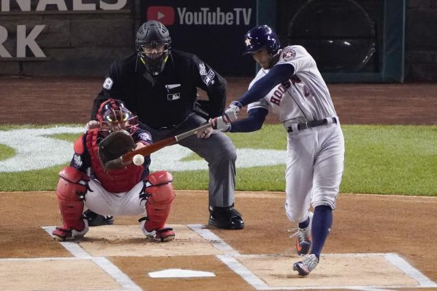Houston Astros' George Springer hits a single during the first inning of Game 3 of the baseball World Series against the Washington Nationals Friday, Oct. 25, 2019, in Washington. (AP Photo/Alex Brandon)