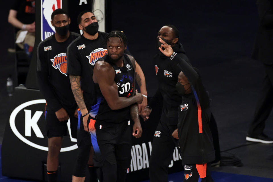 New York Knicks forward Julius Randle (30) reacts with teammates after making a 3-point basket during overtime of an NBA basketball game against the New Orleans Pelicans on Sunday, April 18, 2021, in New York. (AP Photo/Adam Hunger, Pool)