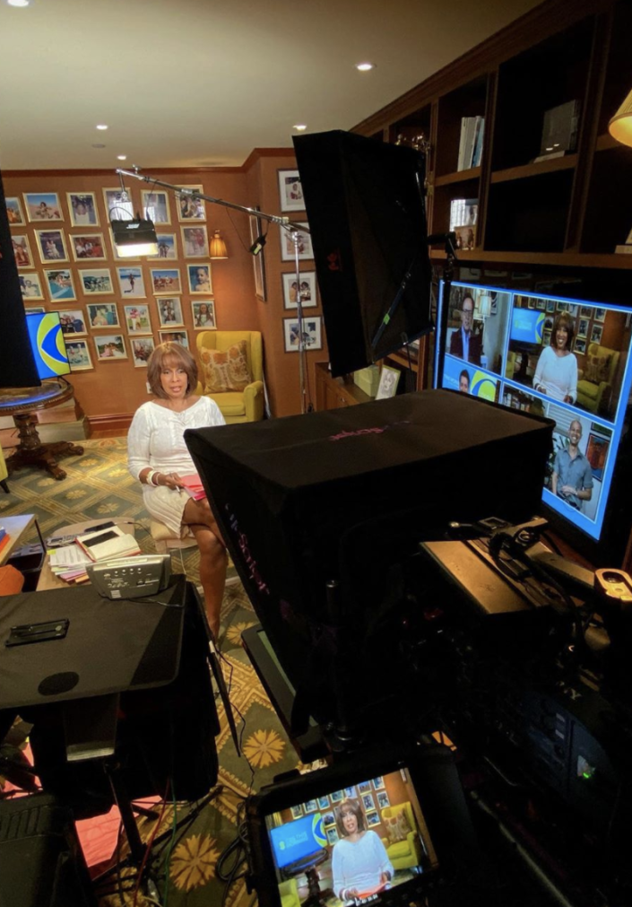 Gayle King delivers the news in front of a wall of framed photos. (Photo: Instagram)