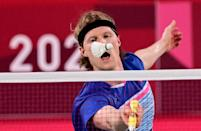 <p>Denmark's Anders Antonsen hits a shot to Indonesia's Anthony Sinisuka Ginting in their men's singles badminton quarter final match during the Tokyo 2020 Olympic Games at the Musashino Forest Sports Plaza in Tokyo on July 31, 2021. (Photo by Pedro PARDO / AFP)</p>