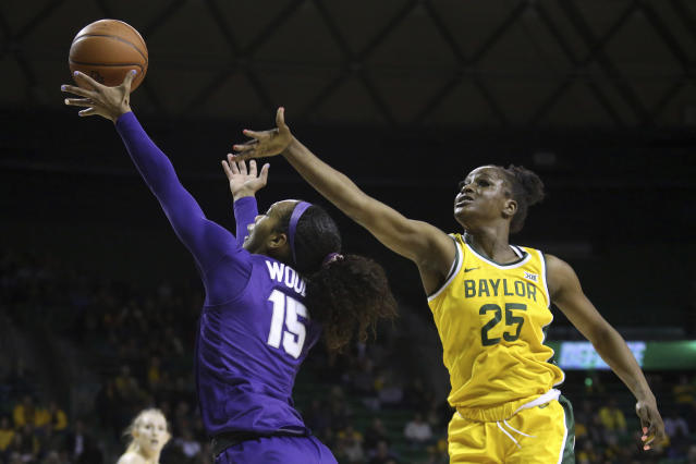 TCU guard Jayde Woods (15) attempts a shot past Baylor center Queen Egbo (25) in the first half of an NCAA college basketball game, Wednesday, Feb. 12, 2020, in Waco, Texas. (AP Photo/Jerry Larson)