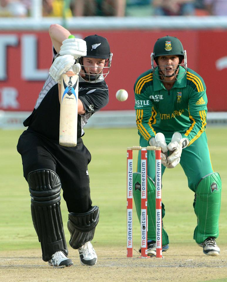 POTCHEFSTROOM, SOUTH AFRICA - JANUARY 25:  Colin Munro of New Zealand bats as Quinton de Kock of South Africa looks on during the 3rd One Day International match between South Africa and New Zealand at Senwes Park on January 25, 2013 in Potchefstroom, South Africa.  (Photo by Lee Warren/Gallo Images/Getty Images)
