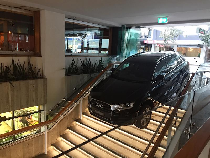 An SUV that ran off the road and into a shopping complex on Hall St, Bondi Beach is pictured.
