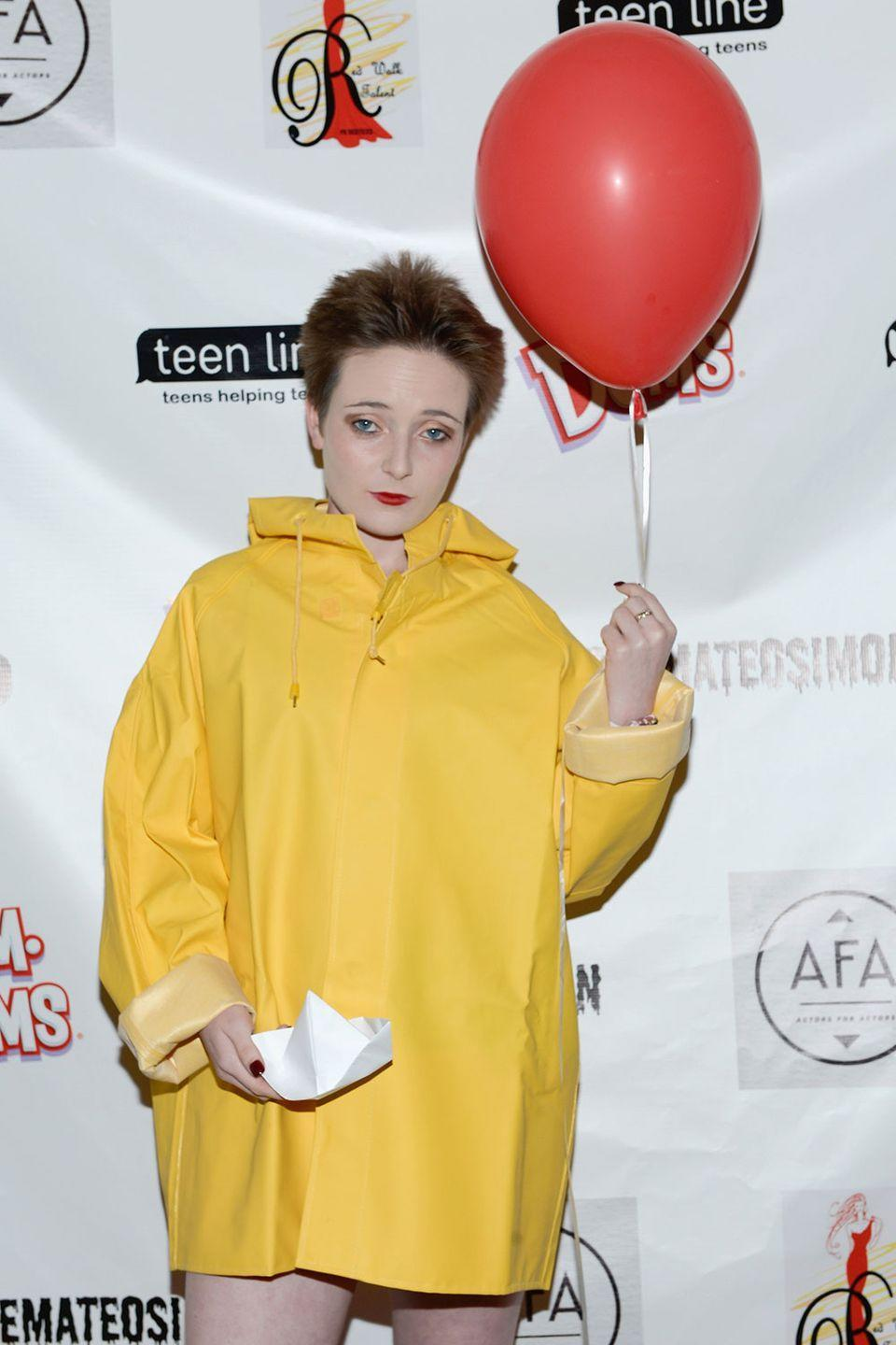 <p><em>It </em>costumes are almost always Pennywise. Katlin Valleroy switched things up by attending a 2017 Halloween charity event as Georgie. Somehow, a rain slicker and a red balloon can still haunt our dreams. </p>