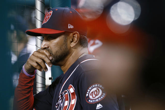 Washington Nationals manager Dave Martinez stands in the dugout during the ninth inning of the teams baseball game against the Atlanta Braves, Friday, Sept. 13, 2019, in Washington. Atlanta won 5-0. (AP Photo/Patrick Semansky)