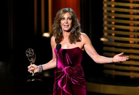 """Allison Janney accepts the award for Outstanding Supporting Actress In A Comedy Series for her role in """"Mom"""" onstage during the 66th Primetime Emmy Awards in Los Angeles, California August 25, 2014. REUTERS/Mario Anzuoni(EMMYS-SHOW) - RTR43QCV"""
