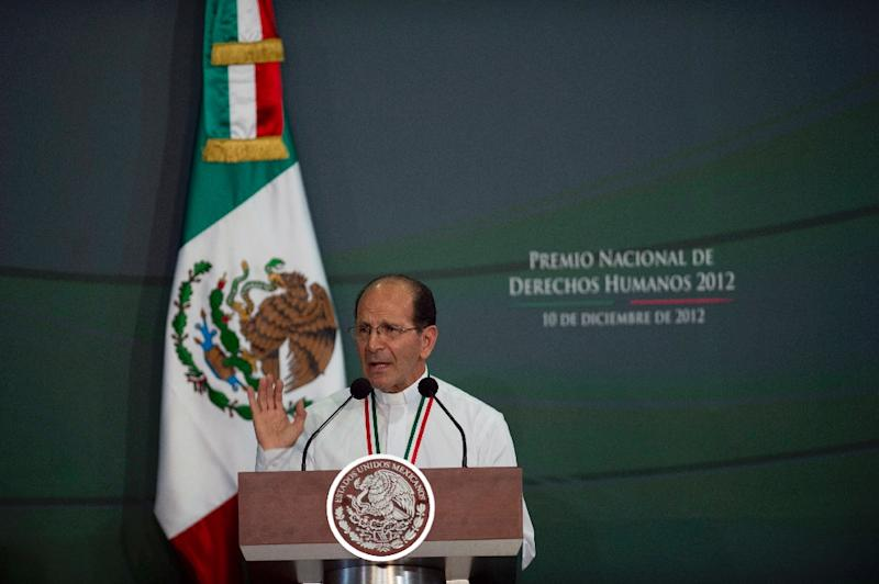 Alejandro Solalinde at a ceremony in which he was decorated with the National Human Rights Award at Los Pinos Presidential Palace in Mexico City on December 10, 2012 (AFP Photo/Yuri Cortez)