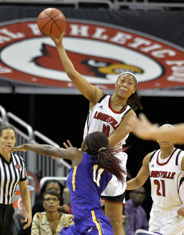 Louisville's Antonita Slaughter, top, throws a pass downcourt over the defense of LSU's Raigyne Moncrief during the second half of an NCAA college basketball game on Thursday, Nov. 14, 2013, in Louisville, Ky. Louisville defeated LSU 88-67. (AP Photo/Timothy D. Easley)