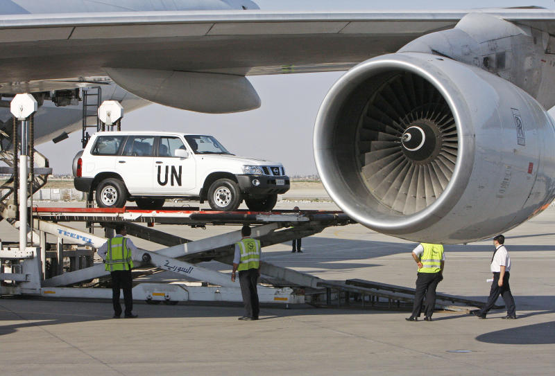 A vehicle for the UN observers is offloaded from a plane at the Damascus airport in Syria, Tuesday, May, 8, 2012. Special envoy Kofi Annan is to brief the U.N. Security Council on Tuesday about the situation in the country, where about 40 U.N. observers are trying to calm the situation. U.N. officials hope to deploy a larger force of up to 300 observers. (AP Photo/Muzaffar Salman)