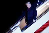 U.S. President Donald Trump disembarks from Air Force One at Joint Base Andrews in Maryland