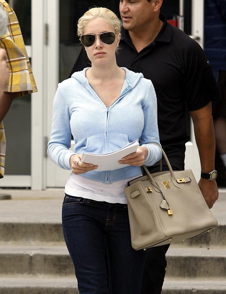 """Also visiting the courthouse Tuesday was a dressed-down, demure Heidi Montag. The """"Hills"""" star filed for legal separation from her husband of just over a year, Spencer Pratt. The separation means that Montag's earnings will become hers alone from the date of filing. Is it all a publicity stunt masterminded by a fame-hungry Pratt? Stay tuned. Ice/<a href=""""http://www.x17online.com"""" target=""""new"""">X17 Online</a> - June 8, 2010"""