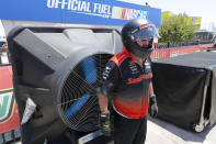 Jim Cahall stands in front of a large fan to cool down from the midday heat during practice for the IndyCar auto race at Texas Motor Speedway in Fort Worth, Texas, Saturday, June 6, 2020. (AP Photo/Tony Gutierrez)
