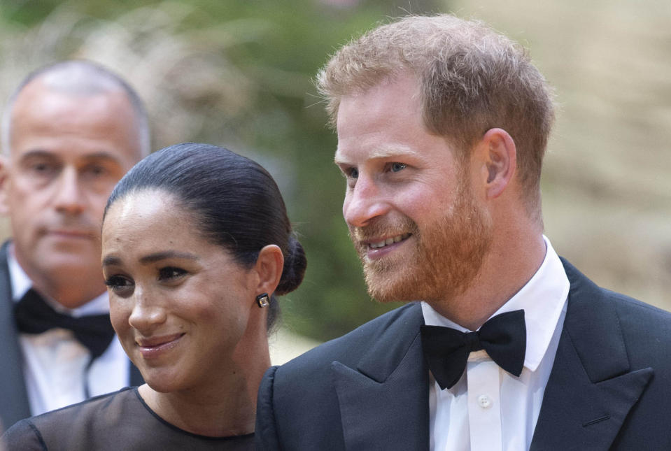 "January 20th 2020 - Buckingham Palace has announced that Prince Harry and Duchess Meghan will no longer use ""royal highness"" titles and will not receive public money for their royal duties. Additionally, as part of the terms of surrendering their royal responsibilities, Harry and Meghan will repay the $3.1 million cost of taxpayers' money that was spent renovating Frogmore Cottage - their home near Windsor Castle. - January 9th 2020 - Prince Harry The Duke of Sussex and Duchess Meghan of Sussex intend to step back their duties and responsibilities as senior members of the British Royal Family. - File Photo by: zz/KGC-178/STAR MAX/IPx 2019 7/14/19 Prince Harry and Duchess Meghan at the premiere of ""The Lion King"" in London, England, UK."