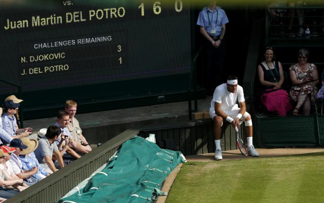 Argentina's Juan Martin Del Potro sits near the score board in his match against Serbia's Novak Djokovic during day eleven of the Wimbledon Championships at The All England Lawn Tennis and Croquet Club, Wimbledon.