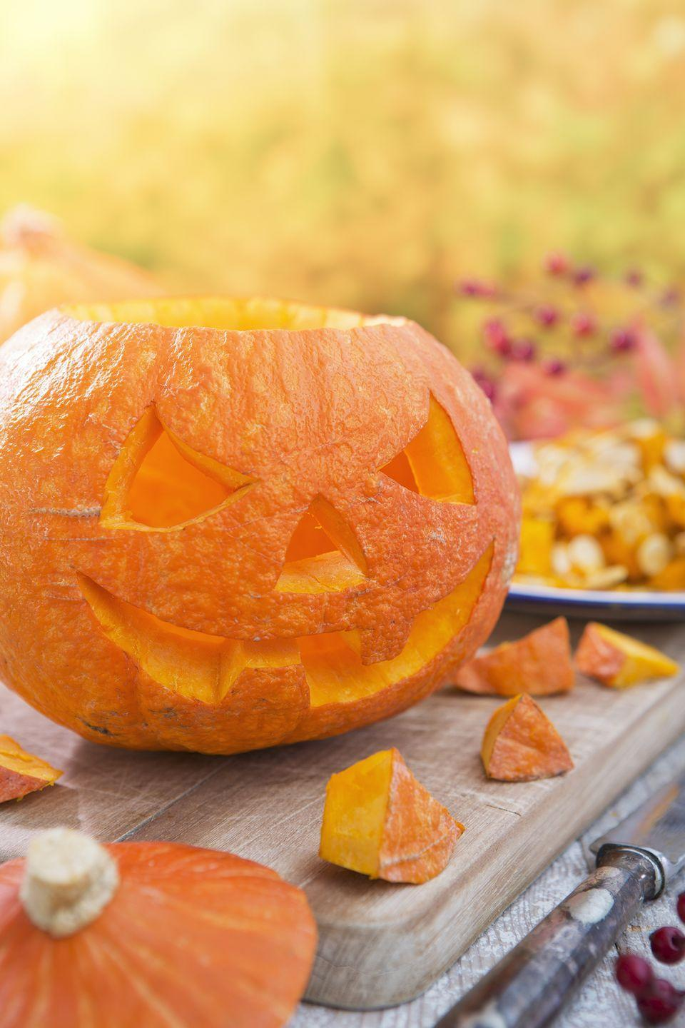 "<p>Lay out a big sheet of kraft paper, then let everyone get busy carving up a storm. (And save all those <a href=""https://www.countryliving.com/food-drinks/g3734/what-to-do-with-pumpkin-seeds/"" rel=""nofollow noopener"" target=""_blank"" data-ylk=""slk:pumpkin seeds to roast later!"" class=""link rapid-noclick-resp"">pumpkin seeds to roast later!</a>)</p><p><strong><a class=""link rapid-noclick-resp"" href=""https://www.amazon.com/Halloween-Haunters-Ultimate-Professional-Lanterns/dp/B074XJHZX7/?tag=syn-yahoo-20&ascsubtag=%5Bartid%7C10050.g.4620%5Bsrc%7Cyahoo-us"" rel=""nofollow noopener"" target=""_blank"" data-ylk=""slk:SHOP PUMPKIN CARVING KIT"">SHOP PUMPKIN CARVING KIT</a></strong></p>"