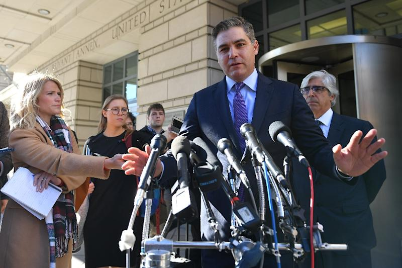 CNN White House correspondent Jim Acosta speaks outside the US District Court in Washington after a judge ordered his press credentials temporarily restored (AFP Photo/MANDEL NGAN)