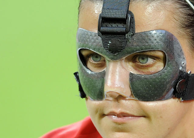 Canada´s striker Christine Sinclair wears a mask prior to the Canada vs Nigeria Group A match of the FIFA women's football World Cup on July 5, 2011 in Dresden, eastern Germany. AFP PHOTO / ROBERT MICHAEL (Photo credit should read ROBERT MICHAEL/AFP/Getty Images)