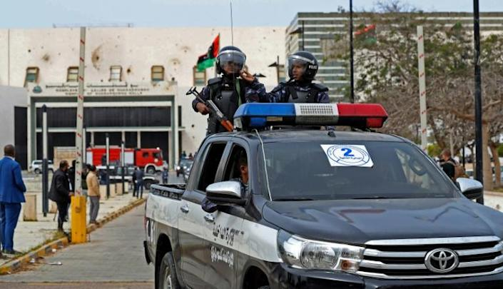 Libyan security forces guarded parliament as they debated the new government