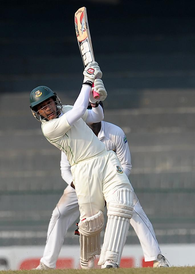 Bangladeshi captain Mushfiqur Rahim plays a shot during the third day of the second Test match between Sri Lanka and Bangladesh at the R. Premadasa Cricket Stadium in Colombo on March 18, 2013. AFP PHOTO/ LAKRUWAN WANNIARACHCHI