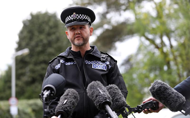 Neighbourhood Inspector Steve Yeoman makes a statement to the media off David's Lane in St Ives, Ringwood - Credit: PA