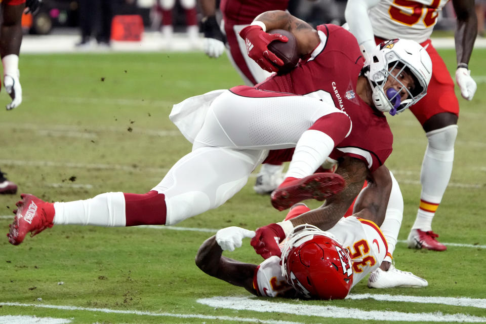 Arizona Cardinals running back James Conner is tackled by Kansas City Chiefs cornerback Charvarius Ward (35) during the first half of an NFL football game, Friday, Aug. 20, 2021, in Glendale, Ariz. (AP Photo/Rick Scuteri)
