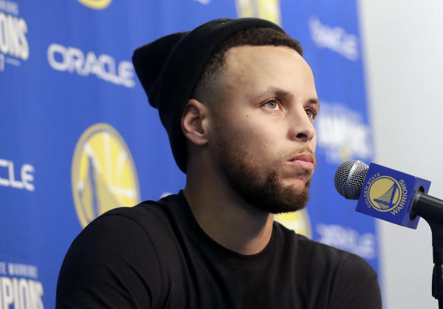 Golden State Warriors guard Stephen Curry speaks at a news conference before an NBA basketball game between the Warriors and the Utah Jazz in Oakland, Calif., Sunday, March 25, 2018. (AP Photo/Jeff Chiu)