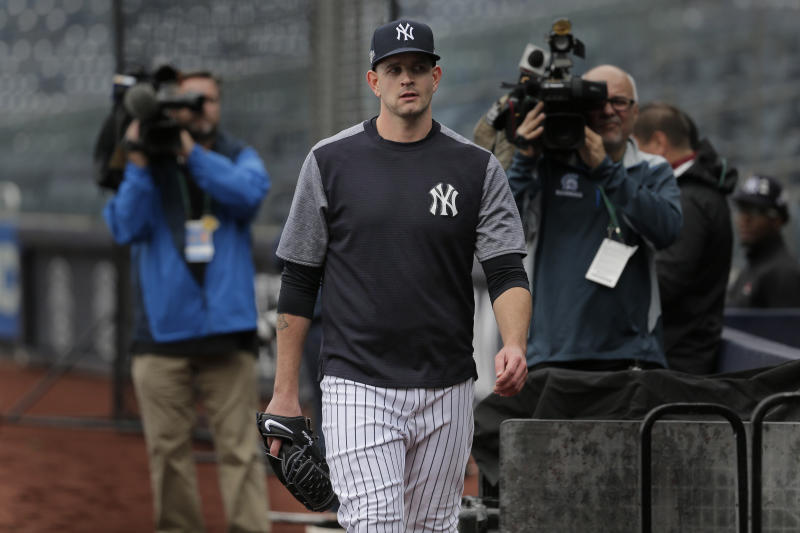 New York Yankees starting pitcher James Paxton leaves the field after throwing in a light drizzle at Yankee Stadium, Thursday, Oct. 3, 2019, in New York. The Yankees will host the Minnesota Twins in the first game of an American League Division Series on Friday. (AP Photo/Seth Wenig)