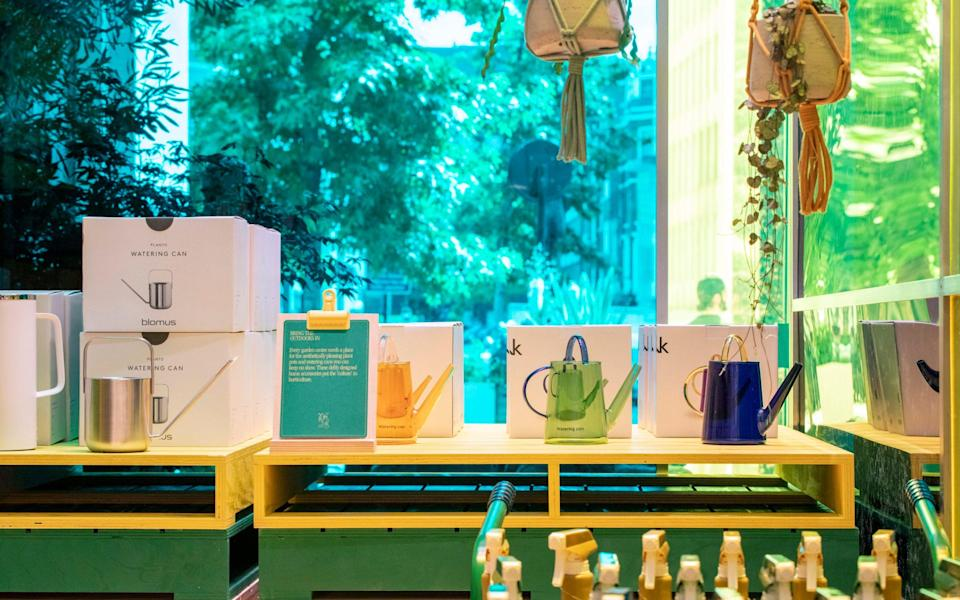 Horti-couture: a selection of designer watering cans on display at Selfridges Garden Centre - Rii Schroer