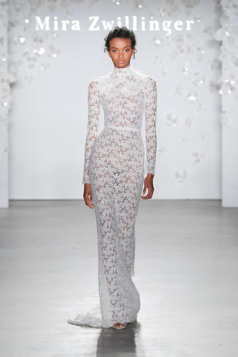 <p>While the higher neckline and long sleeves cover most of the bride's body, the slightly sheer material makes it a more modest version of the naked dress.</p>
