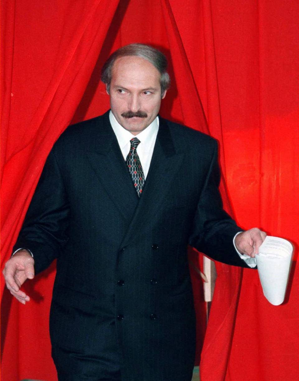 FILE - In this Nov. 24, 1996, file photo, Belarusian President Alexander Lukashenko emerges from the polling booth after marking his ballot in Belarus' national referendum in Minsk, Belarus. When Lukashenko became president in 1994, Belarus was an obscure country that had not even existed for three years. Over the next quarter-century, he brought it to the world's notice via dramatic repression, erratic behavior and colorful threats. (AP Photo/File)