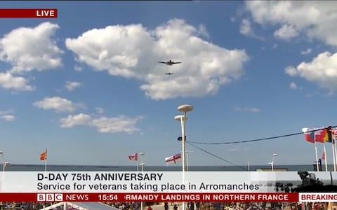 Planes fly over the service in Arromanches - Credit: BBC