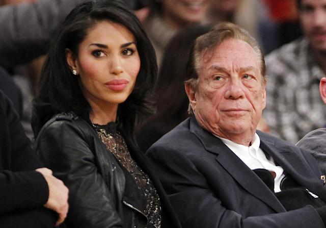 FILE - In this Dec. 19, 2010, file photo, Los Angeles Clippers owner Donald Sterling, right, and V. Stiviano, left, watch the Clippers play the Los Angeles Lakers during an NBA preseason basketball game in Los Angeles. NBA Commissioner Adam Silver is intent on moving quickly in dealing with the racially charged scandal surrounding Clippers owner Sterling. The NBA league will discuss its investigation Tuesday, April 29, 2014, before the Clippers play Golden State in Game 5 of their playoff series. (AP Photo/Danny Moloshok, File)