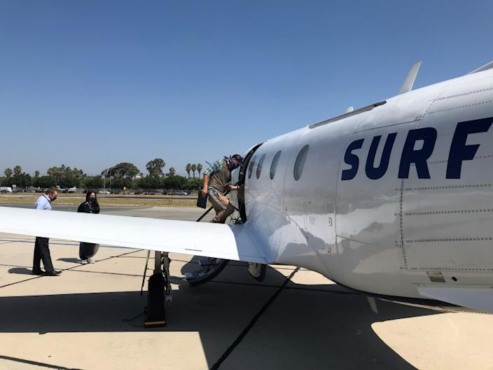 "A passenger on Surf Air boards his flight at Hawthorne Airport on July 10, 2020. <span class=""copyright"">(Hudson Andrews / Surf Air)</span>"