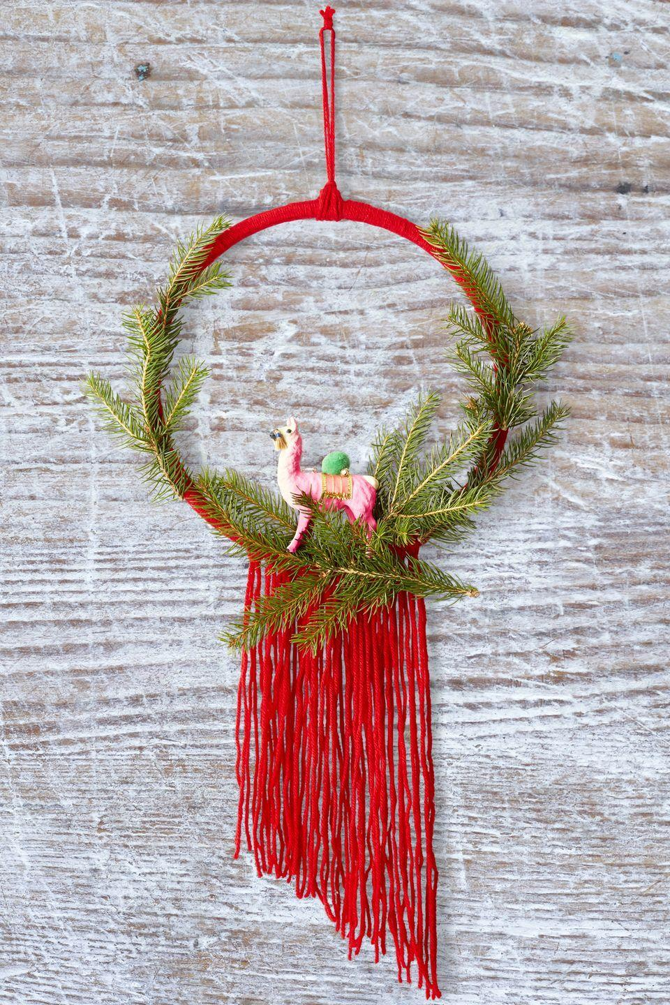 "<p>While this yarn-covered wreath may not withstand your next blizzard, it'll make a stunning door accent for the time being. Stick a pink llama, unicorn, or other mystical creature in the center for a touch of magic. </p><p><strong>RELATED:</strong> <a href=""https://www.goodhousekeeping.com/holidays/christmas-ideas/how-to/g1253/diy-christmas-wreaths/"" rel=""nofollow noopener"" target=""_blank"" data-ylk=""slk:60 Christmas Wreaths to Get You in the Holiday Spirit"" class=""link rapid-noclick-resp"">60 Christmas Wreaths to Get You in the Holiday Spirit</a></p>"