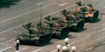 In this June 5, 1989 file photo, a Chinese man stands alone to block a line of tanks heading east on Beijing's Changan Blvd in Tiananmen Square. The man, calling for an end to the recent violence and bloodshed against pro-democracy demonstrators, was pulled away by bystanders, and the tanks continued on their way. Over 7 weeks in 1989, student-led pro-democracy protests centered on Beijing's Tiananmen Square became China's greatest political upheaval since the end of the Cultural Revolution more than a decade earlier. AP Photo/Jeff Widener, File