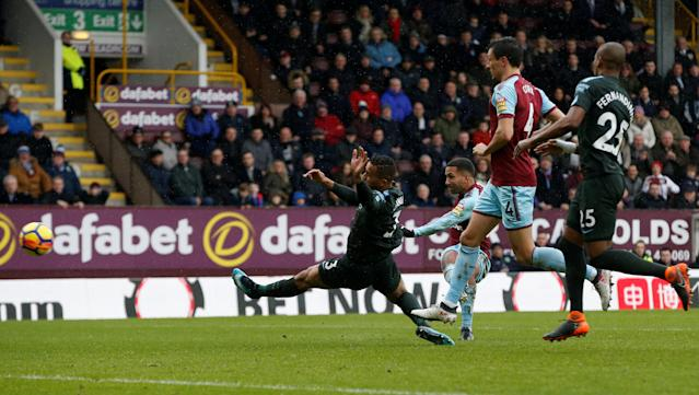 "Soccer Football - Premier League - Burnley vs Manchester City - Turf Moor, Burnley, Britain - February 3, 2018 Burnley's Aaron Lennon has a shot at goal as Manchester City's Danilo attempts to block REUTERS/Andrew Yates EDITORIAL USE ONLY. No use with unauthorized audio, video, data, fixture lists, club/league logos or ""live"" services. Online in-match use limited to 75 images, no video emulation. No use in betting, games or single club/league/player publications. Please contact your account representative for further details."
