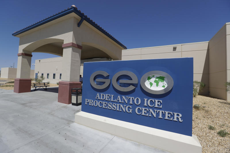 This Wednesday, Aug. 28, 2019, photo shows the Adelanto U.S. Immigration and Enforcement Processing Center operated by GEO Group, Inc. (GEO) a Florida-based company specializing in privatized corrections in Adelanto, Calif. California is banning the use of for-profit, private detention facilities, including those the federal government uses for immigrants awaiting deportation hearings. Gov. Gavin Newsom announced Friday, Oct. 11, 2019 he had signed a measure into law that helps fulfill his promise to end the use of private prisons.(AP Photo/Chris Carlson)