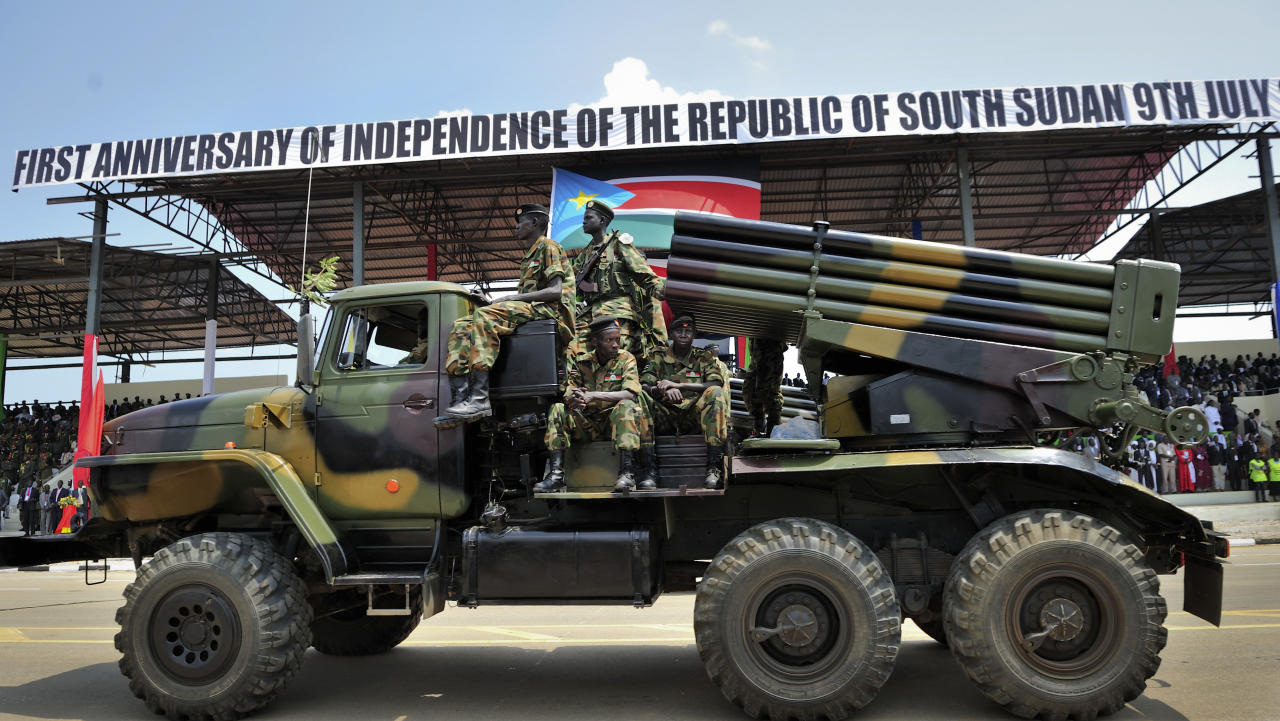 South Sudan's military parade at the country's anniversary celebrations, at the John Garang mausoleum in Juba, South Sudan, Monday, July 9, 2012. The world's newest nation, South Sudan, is celebrating its first birthday and while the largest achievement over the last year was avoiding a return to all-out war with Sudan, the south has seen its economy crippled after it shut down its oil industry and thousands of refugees are streaming into the country every week to avoid violence on Sudan's side of the border. (AP Photo/Shannon Jensen)