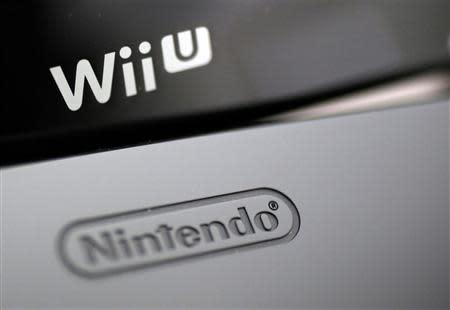 File photo of logos seen on Nintendo Co's Wii U game console and its controller at the company's headquarters in Kyoto