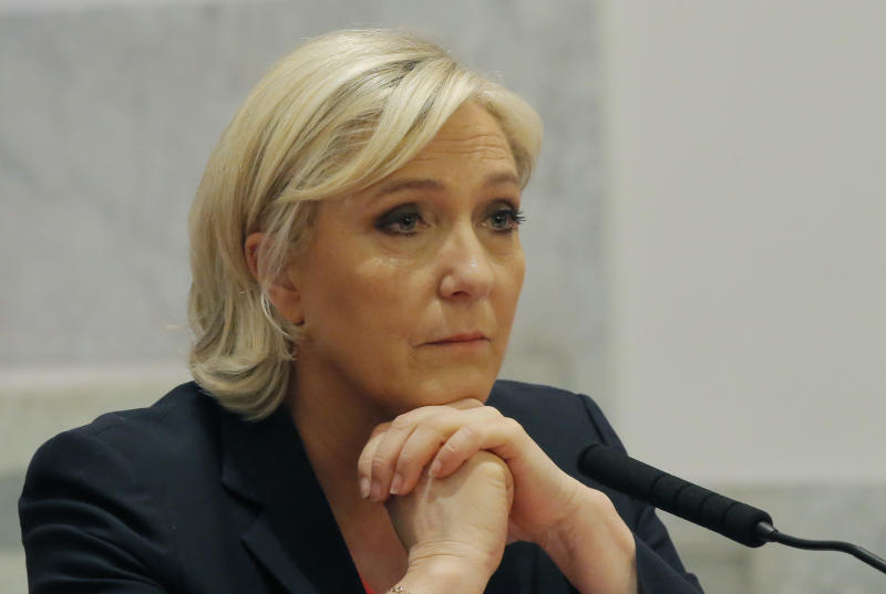 Far-right candidate for the 2017 French presidential election Marine Le Pen attend with Nicolas Dupont-Aignan a media conference in Paris, France, Saturday, April 29, 2017. Far-right candidate Marine Le Pen says her new campaign ally, Nicolas Dupont-Aignan, would be her prime minister if she is elected. (AP Photo/Michel Euler)