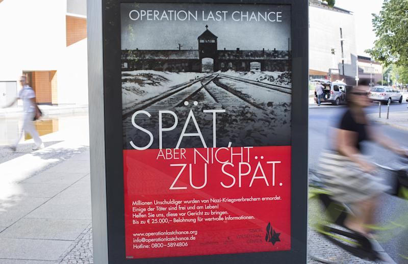 """A placard reading """"Operation last chance - late but not too late"""" is displayed in Berlin, Germany, Tuesday, July 23, 2013. With 2,000 placards in Berlin, Hamburg and Cologne cities the Simon Wiesenthal Center launched another campaign to find and prosecute Nazi war criminals while they are still alive. Efraim Zuroff, the center's top Nazi-hunter, told reporters in Berlin that """"Operation Last Chance II"""" would provide up to euro 25,000 (US$ 32,800) in reward money for information that leads to the investigation and prosecution of war criminals. (AP Photo/Gero Breloer)"""