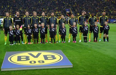 Borussia Dortmund players line up before the game