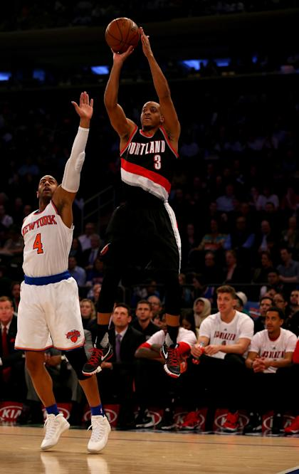 C.J. McCollum got the chance to fire, so he rose. (Elsa/Getty Images)