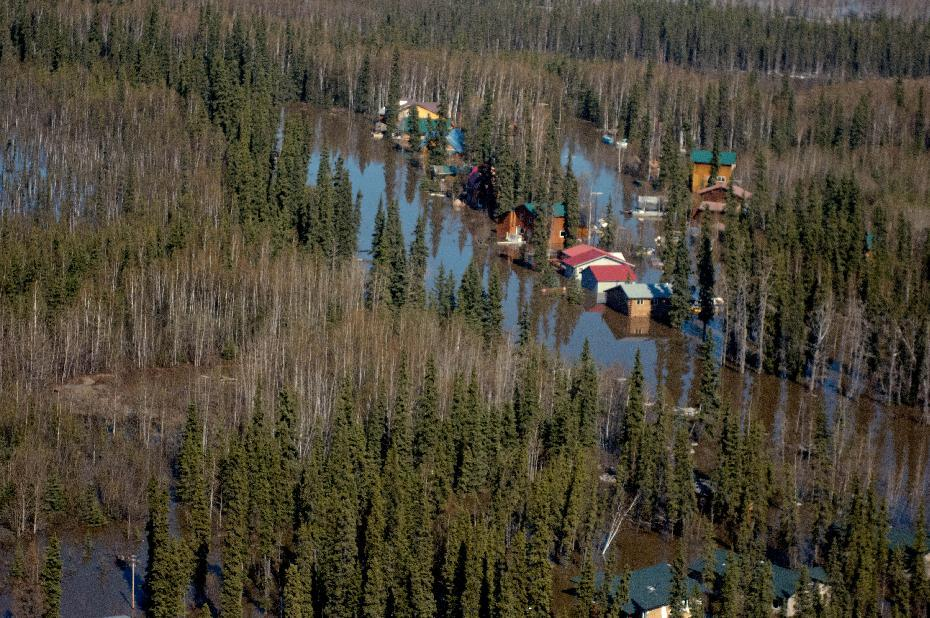 In this May 28, 2013 photo, the town of Galena, Alaska is flooded by the Yukon River during the breakup of winter ice. Several hundred people are estimated to have fled the community of Galena in Alaska's interior, where a river ice jam has caused major flooding, sending water washing over roads and submerging buildings. (AP Photo/Alaska National Guard, Sgt. Edward Eagerton)
