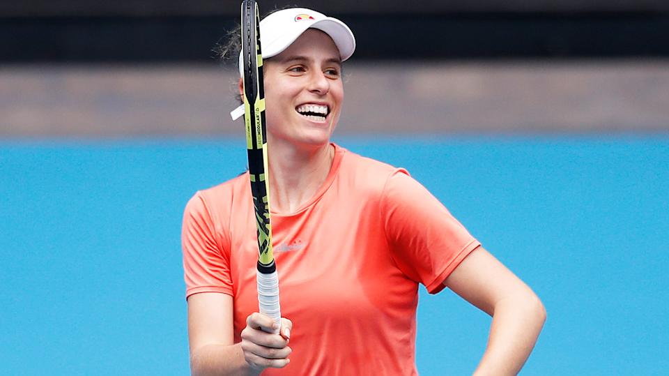 Johanna Konta (pictured) smiles as she trains for the Australian Open.