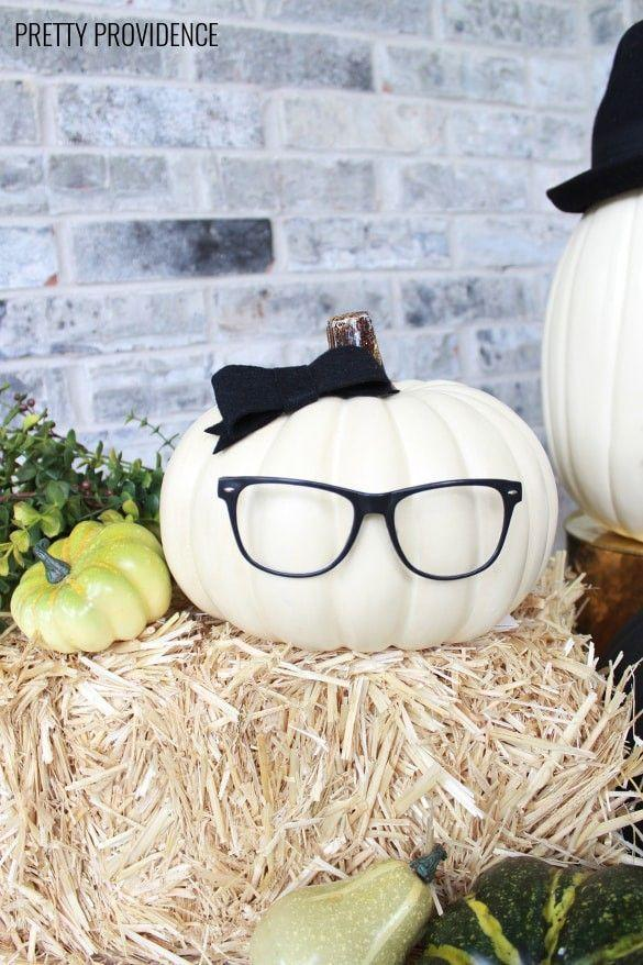"""<p>Not only is this idea adorable, but it's also """"no-carve"""" (just like many of the other ideas on our list!). It's an excellent, easy craft for a last-minute Halloween decorating spree.</p><p><strong>Get the tutorial at <a href=""""https://prettyprovidence.com/no-carve-pumpkin-people/"""" rel=""""nofollow noopener"""" target=""""_blank"""" data-ylk=""""slk:Pretty Providence"""" class=""""link rapid-noclick-resp"""">Pretty Providence</a>.</strong></p><p><strong><strong><strong><strong><a class=""""link rapid-noclick-resp"""" href=""""https://go.redirectingat.com?id=74968X1596630&url=https%3A%2F%2Fwww.walmart.com%2Fsearch%2F%3Fquery%3Dhot%2Bglue%2Bguns&sref=https%3A%2F%2Fwww.thepioneerwoman.com%2Fhome-lifestyle%2Fdecorating-ideas%2Fg36664123%2Fwhite-pumpkin-decor-ideas%2F"""" rel=""""nofollow noopener"""" target=""""_blank"""" data-ylk=""""slk:SHOP HOT GLUE GUNS"""">SHOP HOT GLUE GUNS</a></strong></strong></strong></strong></p>"""
