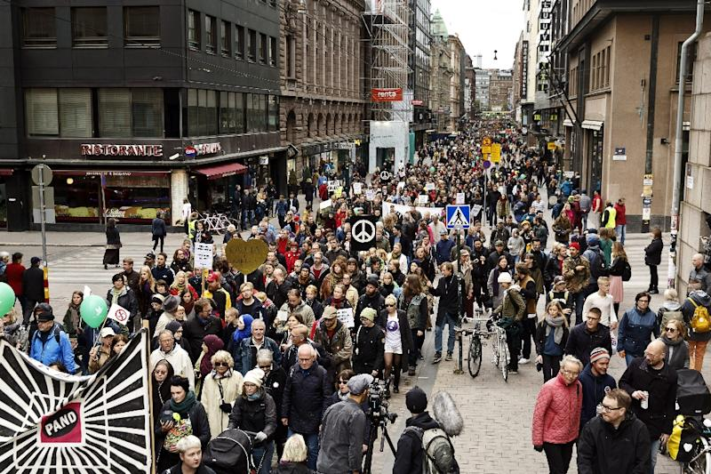 Participants demonstrate against racism and fascism in Helsinki, Finland on September 24, 2016 (AFP Photo/Roni Rekomaa)