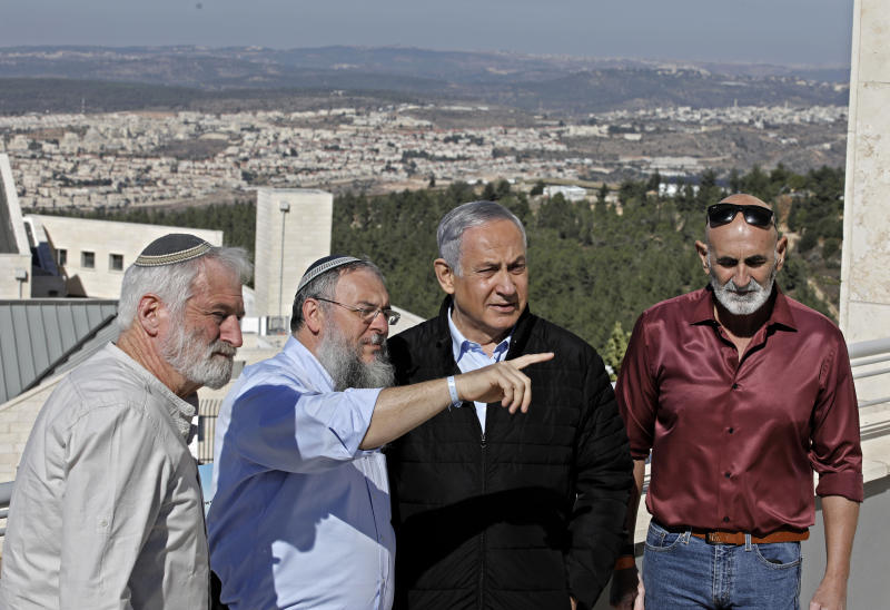 Israeli Prime Minister Benjamin Netanyahu, second right, meets with heads of Israeli settlement authorities at the Alon Shvut settlement, in the Gush Etzion block, in the occupied the West Bank, Tuesday, November 19, 2019. (Menahem Kahana/ Pool via AP)